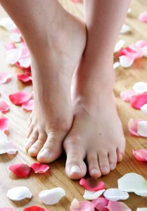 bigstock-feet-surrounded-by-rose-petals-20318591
